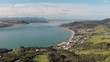 Aerial view flying towards Omapere, New Zealand. Beautiful town near river and hills.