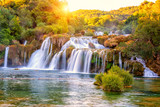 Amazing nature landscape, beautiful waterfall at sunrise, famous Skradinski buk, one of the most beautiful waterfalls in Europe and the biggest in Croatia, outdoor travel background