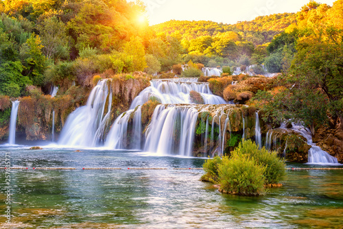 Amazing nature landscape, beautiful waterfall at sunrise, famous Skradinski buk, one of the most beautiful waterfalls in Europe and the biggest in Croatia, outdoor travel background - 257835771