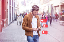 Young Adult Man Using Social Media On Smartphone On The Street At Summer Time - Like, Follower, Comment Icons In Speech Bubble