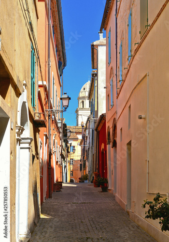 Wall Murals Detail of narrow street in old small village Sirolo Conero with historical houses and windows, Marche Italy