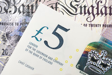 Close-up Of 5 Pound Sterling England Currency Banknotes, Brexit, UK Economics, Saving, Financial Or Investment With Europe, Business Profit And Loss Concept