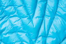 Close-up On Blue Puffer Jacket Texture. Background Of Quilted Material
