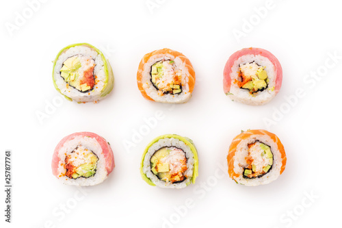 Fototapeta Flat lay with colorful sushi rolls with crab meat on white background obraz