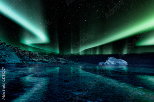 Printed kitchen splashbacks Northern lights iceberg floating in greenland fjord at night with green northern lights