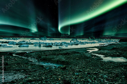 Wall Murals Northern lights iceberg floating in greenland fjord at night with green northern lights