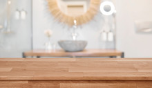 Wooden Table Top In Front Of Blurred Bathroom Interior Background