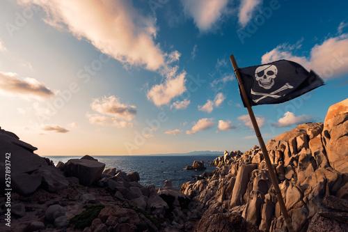 coastal landscape of rocks with jolly roger flag Fototapeta