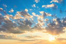 Real Sunrise Sky With Beautiful Light Clouds, Sun And Sunbeams