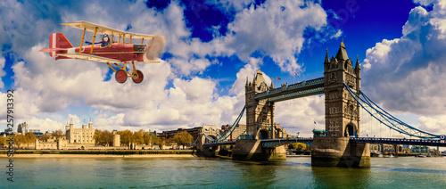 Aircraft, girl pilot aviator in airplane flying over Thames river, Tower Bridge London Wallpaper Mural