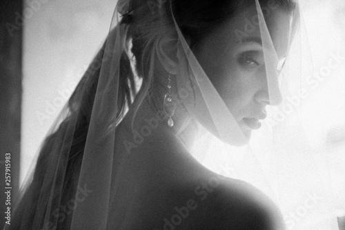 Bride posing close up in a veil Wallpaper Mural