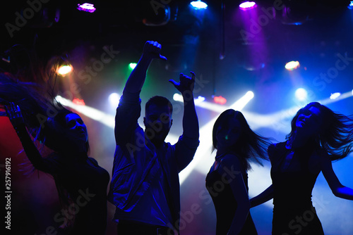 party, holidays, celebration, nightlife and people concept - group of happy frie Canvas Print