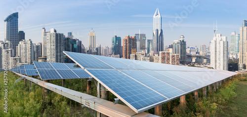 Obraz Solar panels and urban construction background - fototapety do salonu