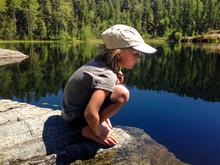 Girl Looking At Lake While Cro...