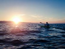 Man Kayaking On Flathead Lake