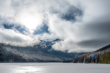 View Of Stanton Lake With Mountains Against Cloudy Sky