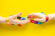 LGBT symbol - wo women's hands wrapped in rainbow ribbon stretch one to one, the concept of the difficulty of same-sex love and separation