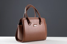 Elegant Reptile Leather Light Brown Women Bag On White Table And