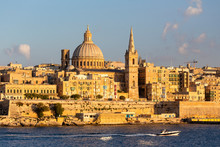 View Of Valletta Waterfront With Basilica Dome Against Sky