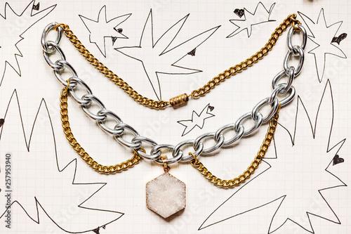 Fotografie, Obraz  Funky Punk style metal choker necklace on paper background
