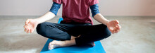 Young Skinny Man Doing Yoga Meditation On The Floor F