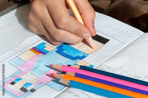 Child hand draws the multicolored minecraft picture. Wallpaper Mural