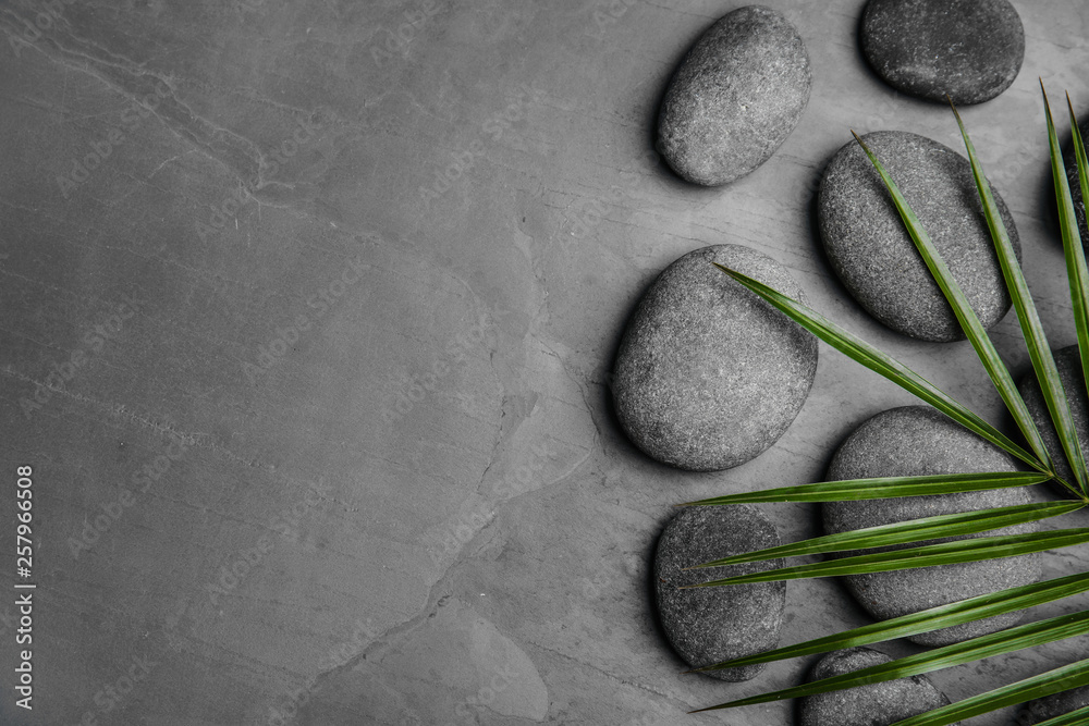 Fototapety, obrazy: Zen stones and tropical leaf on dark background, top view with space for text