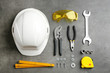 canvas print picture - Flat lay composition with different construction tools on grey background