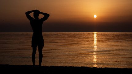 Sihouette of a man on the beach at sunset