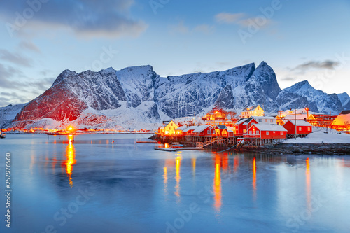 Foto auf Gartenposter Blau Jeans Moskenes island on Lofoten islands archipelago in Norway over polar circle, Scandinavia, Europe - Lovely dusk scene of Villages Reine and Hamnoy: Reine fjord and snow-capped mountains in background.