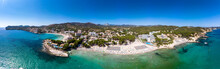 Spain, Balearic Islands, Mallorca, Region Calvia, Costa De La Calma, Peguera, Aerial View Of Beach With Hotels, Panorama