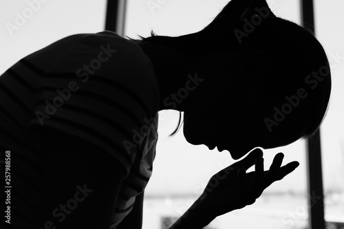 silhouette of young woman feeling tired and stressed Fototapeta