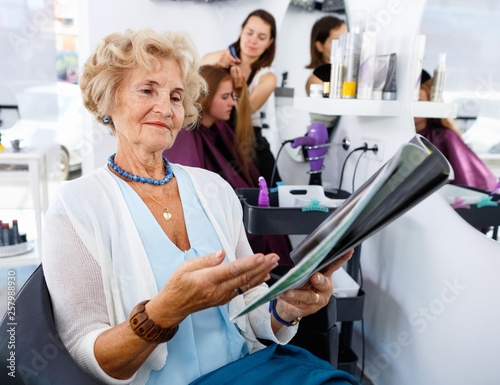 Pleasing Smiling Elderly Female Client Sitting With Magazine In Chair Download Free Architecture Designs Rallybritishbridgeorg