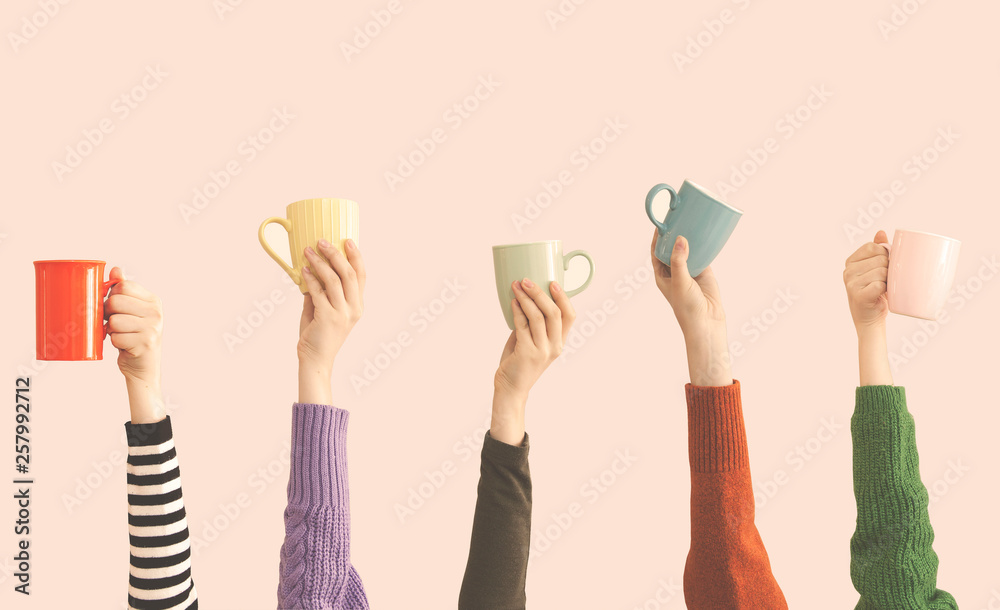 Fototapety, obrazy: Many different arms raised up holding coffee cup