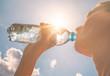 Leinwanddruck Bild - Young woman drinking bottle of water
