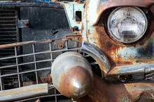 Old Rusty And Damaged Antique Car Wreck In Very Poor Condition On House Yard.