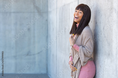 Outdoor portrait of beautiful African American woman outside with black hair and Wallpaper Mural