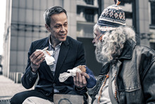 Communicative Kind Man Talking To Grey-haired Senior Homeless