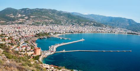 Panoromic view of Alanya peninsula - Ancient shipyard near Red Tower (Kizil Kule) in - Antalya, Turkey