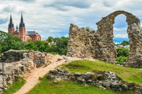 Foto auf Leinwand Beige Old stone ruins of an ancient church. Latvian landscape