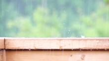 Heavy Rain On A Porch Railing