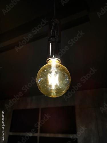 light bulb glowing in dark Canvas Print