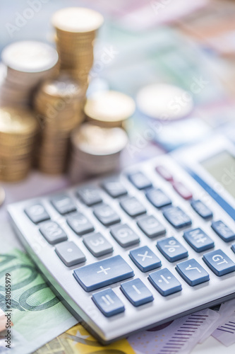 Close-up euro coins and banknotes with calculator - 258055979