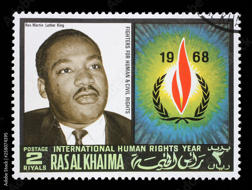 Photo  Stamp issued in the Ras al Khaimah shows Martin Luther King (1929-1968), International Human Rights Year, circa 1968