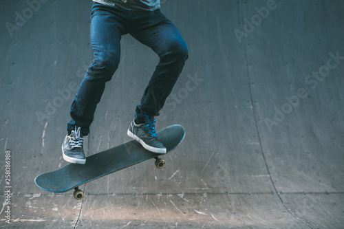 Urban man hobby. Skateboarding leisure and practice. Guy performing trick. Skate park ramp. Action shot. Copy space.