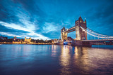 Fototapeta Londyn - Illuminated Tower Bridge right after the sunset