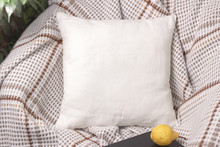 White Linen Pillow On A Chair ...