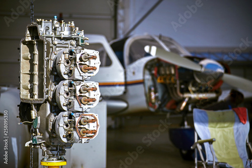 Fotografia, Obraz  Removal and repair of an airplane engine by a service worker.
