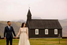 Beautiful Wedding Couple Posing With Black Old Church