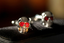 Two Silver Skulls